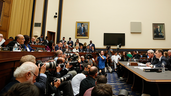 Former special counsel Robert Mueller, accompanied by his top aide in the investigation Aaron Zebley, right, testifies before the House Judiciary Committee hearing on his report on Russian election interference, on Capitol Hill, Wednesday, July 24, 2019 in Washington. (AP Photo/Alex Brandon)