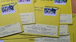 photo of festive stamped yellow envelopes postmarked as return to sender